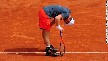 PARIS, FRANCE - MAY 31:  Andy Murray of Great Britain doubles up as he struggles with a back problem during his men's singles second round match against Jarkko Nieminen of Finland during day five of the French Open at Roland Garros on May 31, 2012 in Paris, France.  (Photo by Mike Hewitt/Getty Images)