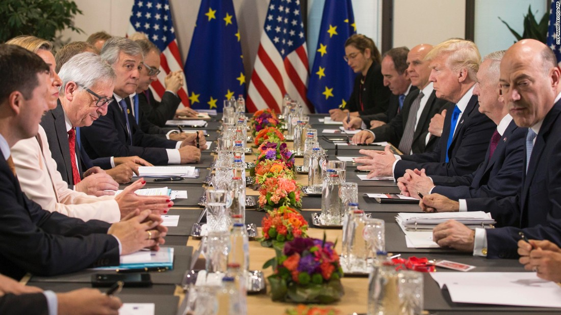 Trump, third from right, attends a meeting with leaders at the European Council.
