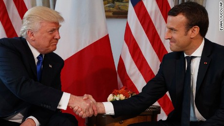 President Donald Trump shakes hands with French President Emmanuel Macron during a meeting at the U.S. Embassy, Thursday, May 25, 2017, in Brussels. (AP Photo/Evan Vucci)