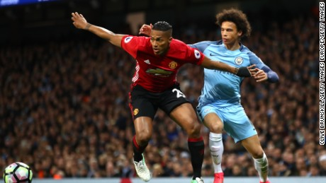 MANCHESTER, ENGLAND - APRIL 27: Antonio Valencia of Manchester United and Leroy Sane of Manchester City in action during the Premier League match between Manchester City and Manchester United at Etihad Stadium on April 27, 2017 in Manchester, England.  (Photo by Clive Brunskill/Getty Images)