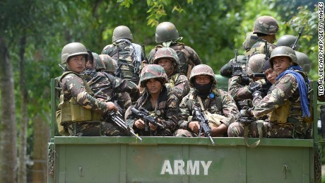 Philippine soldiers arrive to reinforce comrades at a military camp in Marawi, on the southern island of Mindanao, days after Muslim extremists attacked the city.