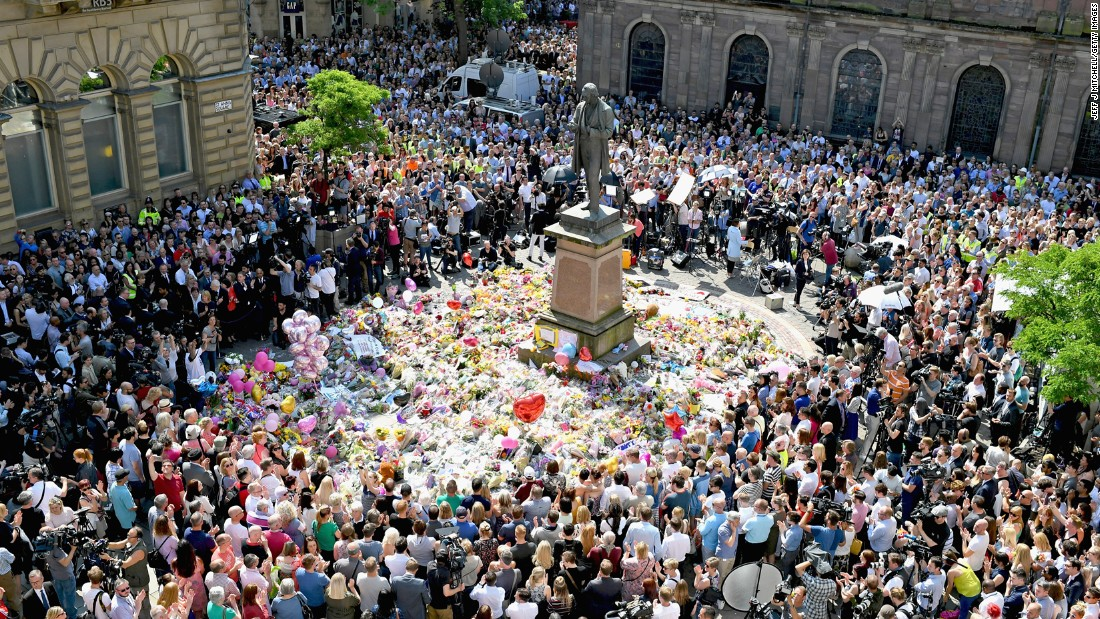 "People in Manchester, England, gather in St. Ann's Square on Thursday, May 25. They were observing a national minute of silence to remember <a href=""http://edition.cnn.com/2017/05/23/europe/manchester-attack-victims/index.html"" target=""_blank"">the victims </a>of a suicide bombing at an Ariana Grande concert."