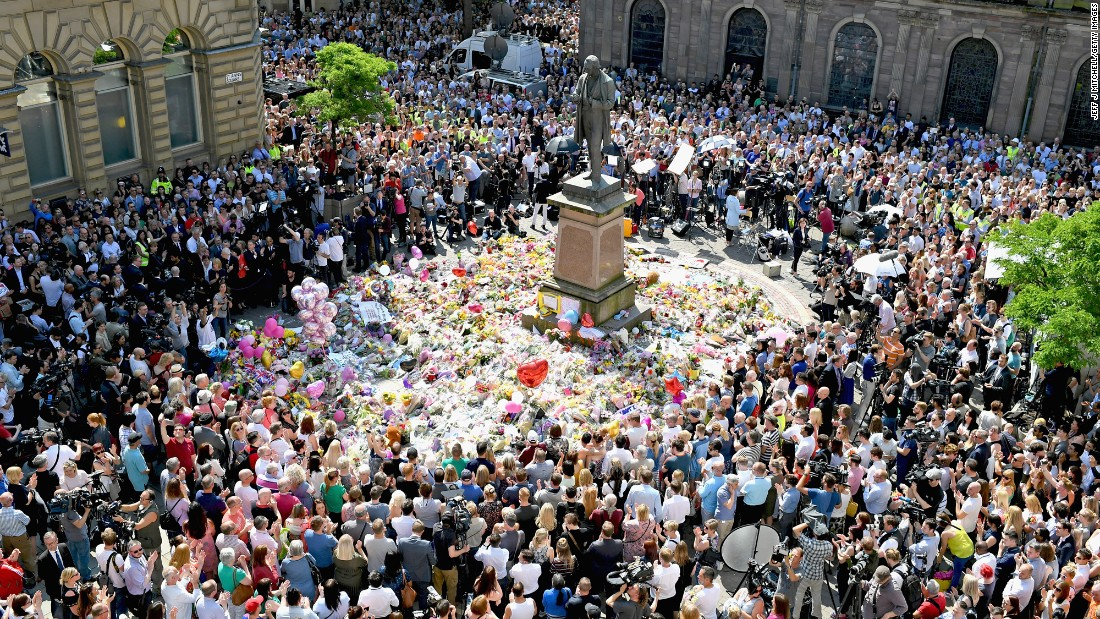 "People in Manchester, England, gather in St. Ann's Square on Thursday, May 25. They were observing a national minute of silence to remember the victims of <a href=""http://www.cnn.com/2017/05/22/europe/gallery/manchester-arena-incident/index.html"" target=""_blank"">a suicide bombing</a> at an Ariana Grande concert. <a href=""http://www.cnn.com/2017/05/23/europe/manchester-attack-victims/index.html"" target=""_blank"">Who were the victims? Read their stories</a>"