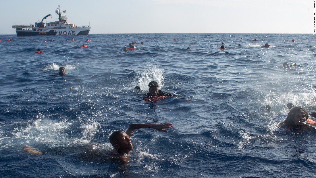 Migrants swim in the Mediterranean Sea after their wooden boat capsized near the Italian island of Lampedusa on Wednesday, May 24. More than 600 people were rescued, but at least 30 people died.