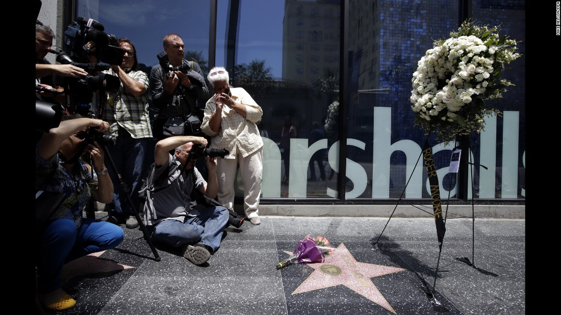"Photographers take pictures of Roger Moore's star on the Hollywood Walk of Fame on Tuesday, May 23. Moore, the English actor famous for portraying James Bond in seven films between 1973 and 1985, <a href=""http://www.cnn.com/2017/05/23/entertainment/roger-moore-dies/index.html"" target=""_blank"">died Tuesday</a> after a battle with cancer, according to his family. He was 89. <a href=""http://www.cnn.com/2017/05/23/entertainment/gallery/roger-moore/index.html"" target=""_blank"">See more photos from his career</a>"