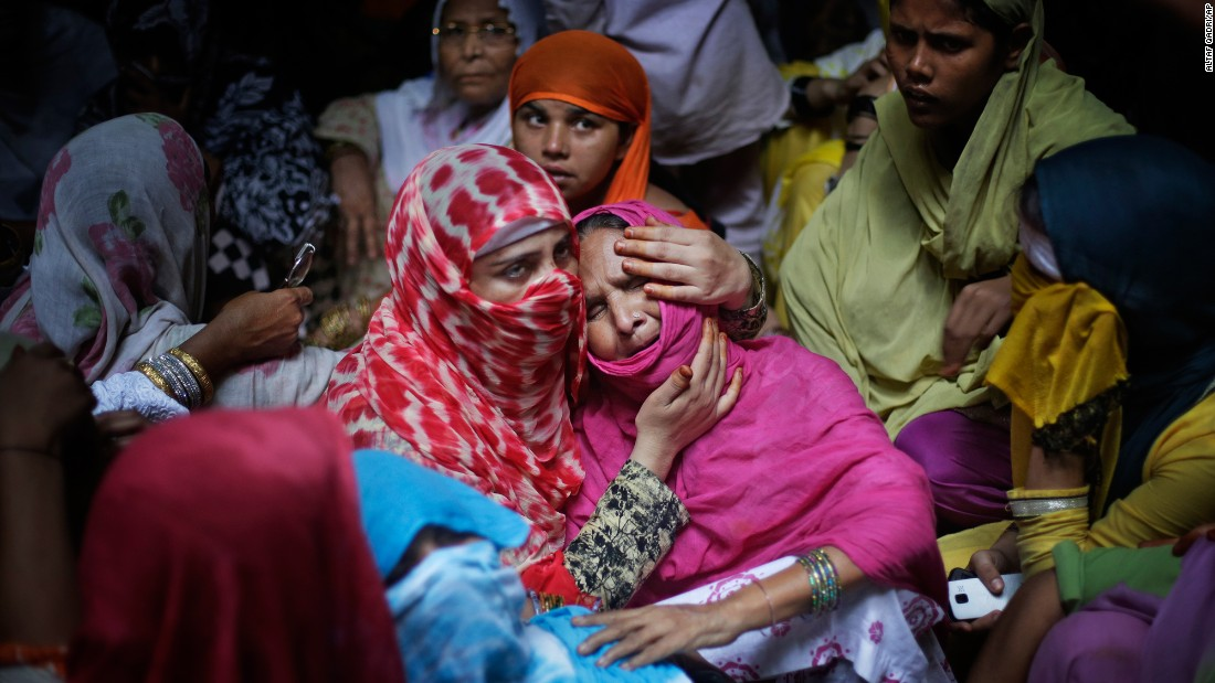 A woman comforts the mother of Shakil, a 38-year-old man who police say was killed by a gang of highway robbers near Jewar, India, on Thursday, May 25. Police say Shakil was shot after trying to save four women who were allegedly raped.