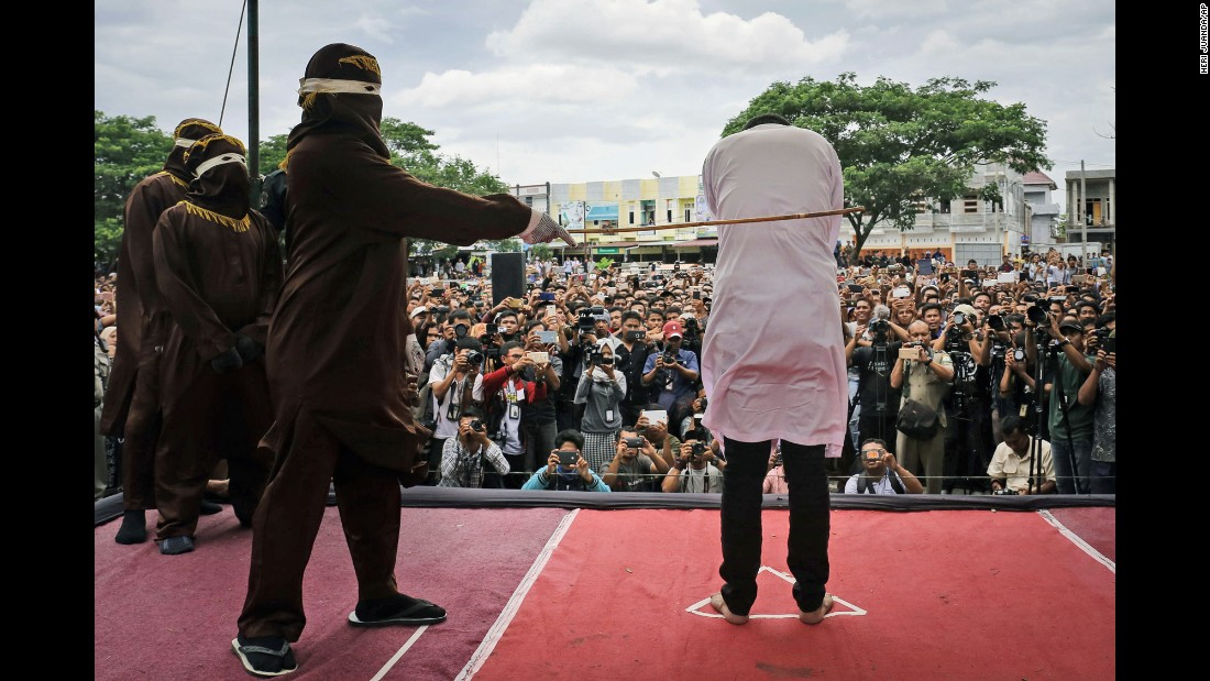 "A man is publicly caned outside a mosque in Banda Aceh, Indonesia, on Tuesday, May 23. <a href=""http://www.cnn.com/2017/05/23/asia/indonesia-caning-homosexuality/"" target=""_blank"">Two men were caned 83 times</a> as a punishment for having homosexual sex in Indonesia's ultra-conservative Aceh province."