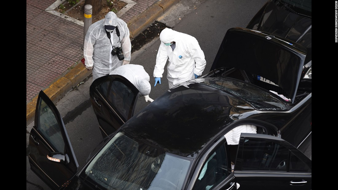 "A forensics team searches for evidence in and around the car of Lucas Papademos, the former Greek prime minister who was injured Thursday, May 25, by <a href=""http://www.cnn.com/2017/05/25/europe/greece-ex-prime-minister-injured-letter-bomb/"" target=""_blank"">a letter bomb explosion</a> in Athens, Greece. Papademos opened the booby-trapped envelope as his vehicle made its way through a central Athens intersection, CNN Greece reported."