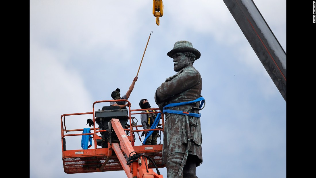 "Workers in New Orleans prepare to take down the statue of former Confederate Gen. Robert E. Lee on Friday, May 19. It is <a href=""http://www.cnn.com/2017/05/19/us/new-orleans-confederate-monuments/"" target=""_blank"">the fourth Confederate monument</a> that the city has removed since late April."