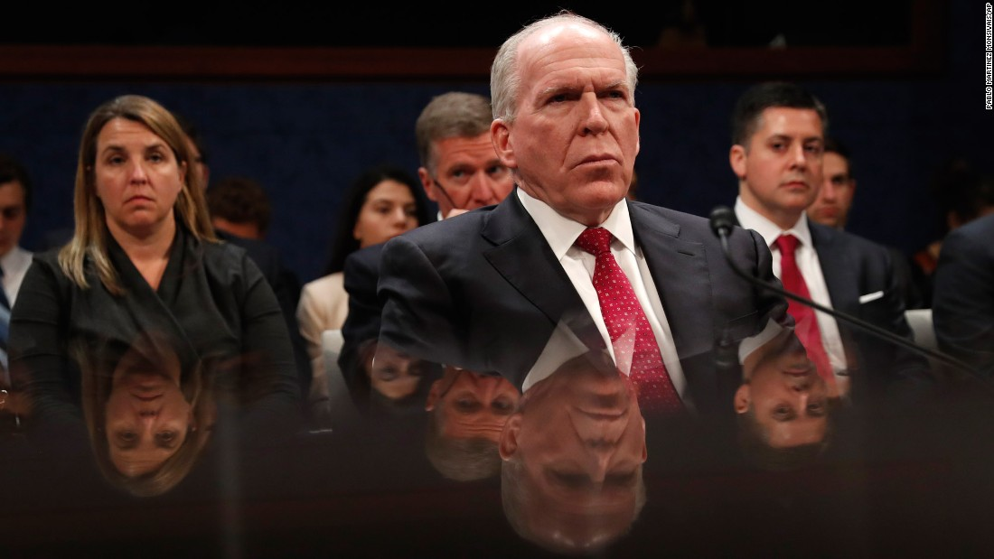 "Former CIA Director John Brennan is reflected by a table as he prepares to testify in Washington on Tuesday, May 23. <a href=""http://www.cnn.com/2017/05/23/politics/john-brennan-house-intelligence-committee/"" target=""_blank"">He told House investigators</a> that Russia ""brazenly interfered"" in US elections, including actively contacting members of Donald Trump's campaign. But he stopped shy of dubbing it ""collusion."""