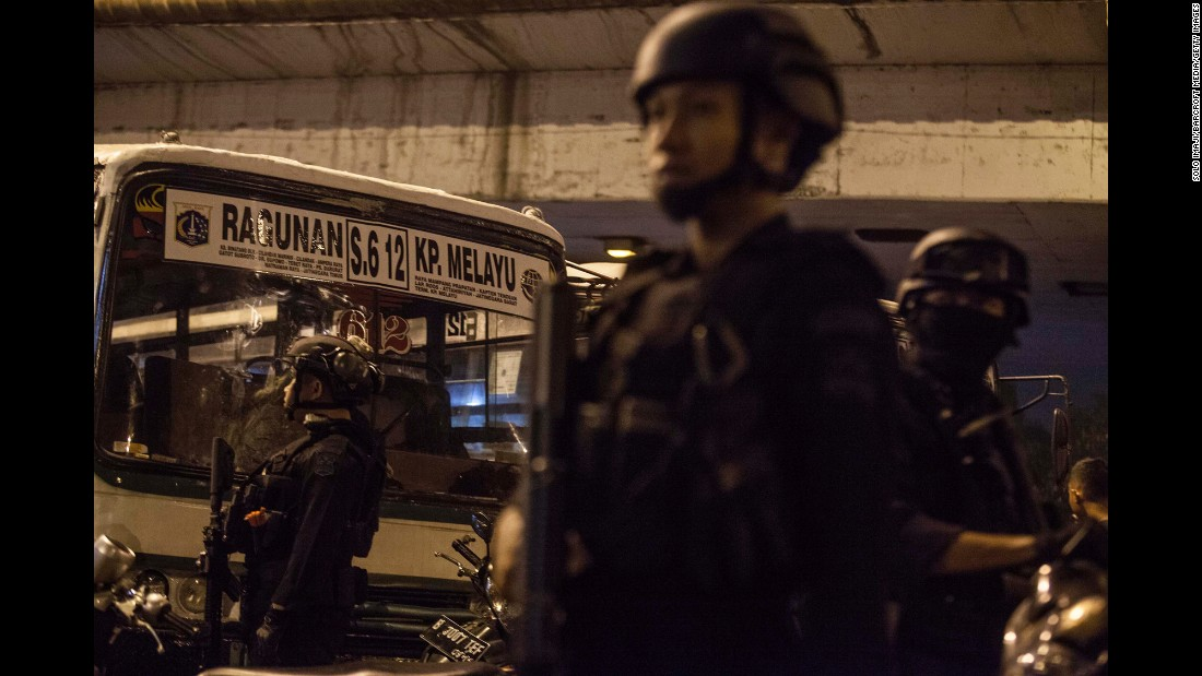 "Police officers stand guard at the site of <a href=""http://www.cnn.com/2017/05/24/asia/jakarta-indonesia-explosion/"" target=""_blank"">twin bomb explosions</a> in Jakarta, Indonesia, on Wednesday, May 24. A pair of suicide bombers struck a bus station, killing at least three officers and wounding at least 11 other people."