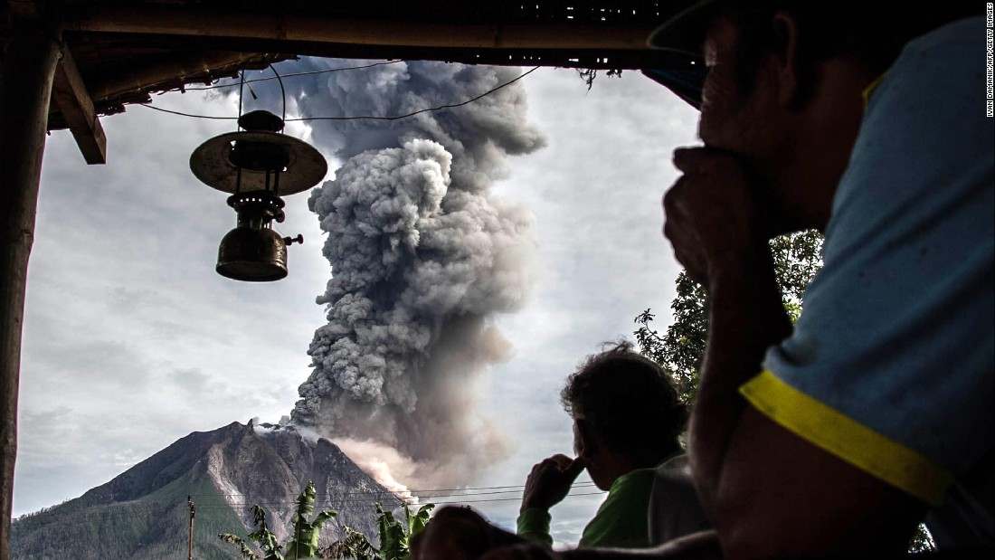 "Villagers watch Mount Sinabung spew thick volcanic ash in Karo, Indonesia, on Friday, May 19. <a href=""http://www.cnn.com/2017/05/18/world/gallery/week-in-photos-0519/index.html"" target=""_blank"">See last week in 26 photos</a>"