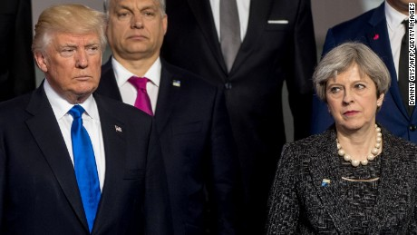 US President Donald Trump (L) and Britain's Prime Minister Theresa May (R) pose for a family picture during the NATO (North Atlantic Treaty Organization) summit at the NATO headquarters, in Brussels, on May 25, 2017. / AFP PHOTO / POOL / Danny GYS        (Photo credit should read DANNY GYS/AFP/Getty Images)