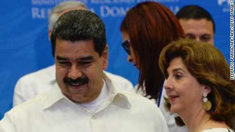 Venezuelan President Nicolas Maduro (L) and Colombia's Foreign Affairs minister Maria Angela Holguin pose during the family picture of the Fifth Summit of the Community of Latin American and Caribbean States (CELAC) in Bavaro, Dominican Republic, on January 25, 2017. Latin American and Caribbean leaders gather Wednesday to discuss regional trade, migration and drug policies in an uncertain new era of foreign relations under new US President Donald Trump. / AFP / FEDERICO PARRA        (Photo credit should read FEDERICO PARRA/AFP/Getty Images)