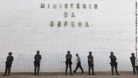 BRASILIA, BRAZIL - MAY 25:  Army soldiers stand guard in front of the Ministry of Defense after President Michel Temer ordered troops to guard the streets following yesterday's violent protests on May 25, 2017 in Brasilia, Brazil. Temer revoked his order today amidst criticism the order was overblown and an attempt to hold on to power. (Photo by Mario Tama/Getty Images)