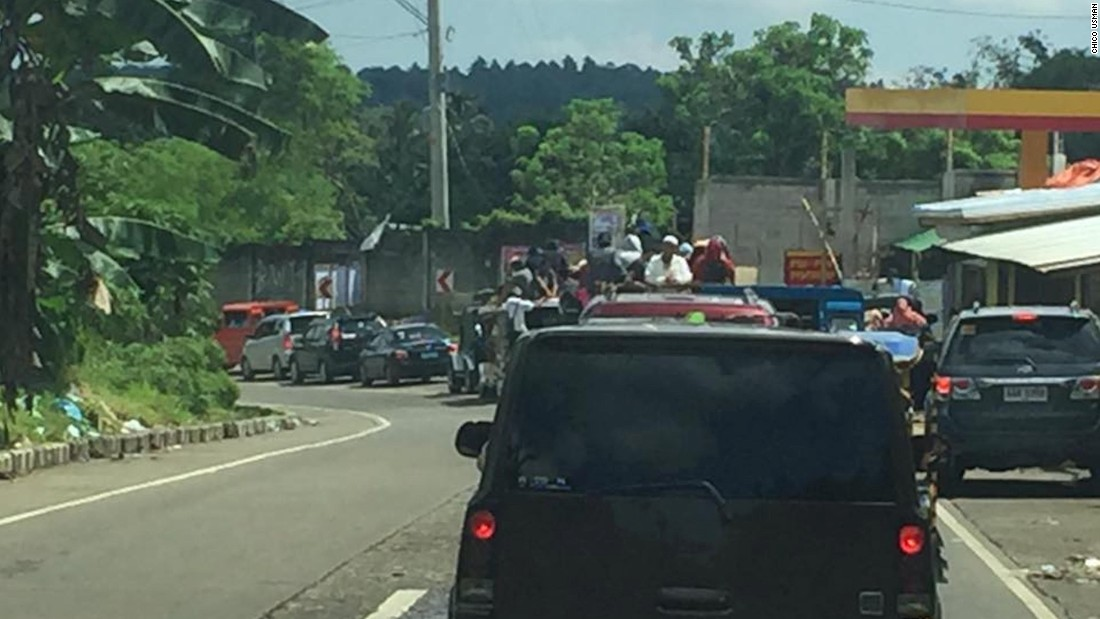 Residents of Marawi in the southern Philippines flee the city as government forces and ISIS militants clash.