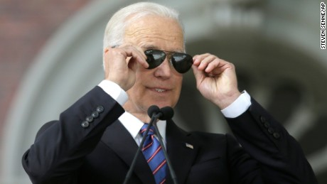 Former Vice President Joe Biden takes off sunglasses as he delivers the annual Harvard College Class Day address, Wednesday, May 24, 2017, on the campus of Harvard University, in Cambridge, Mass. (AP Photo/Steven Senne)