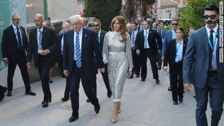 US President Donald Trump and First Lady Melania Trump arrive for a concert of La Scala Philharmonic Orchestra at the ancient Greek Theatre of Taormina during the Heads of State and of Government G7 summit, on May 26, 2017 in Sicily. / AFP PHOTO / POOL / MANDEL NGAN        (Photo credit should read MANDEL NGAN/AFP/Getty Images)