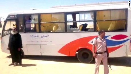Security officials at the site of the bus attack near Minya on Thursday.