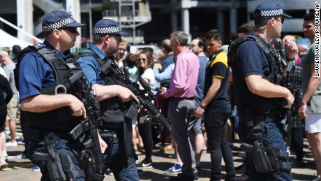 Armed police officers patrol outside the Aviva Premiership Rugby Final between Exeter and Wasps at Twickenham stadium in London on Saturday, May 27. Britons have been encouraged to enjoy their Bank Holiday weekend as planned after police reviewed security at more than 1,300 events following the Manchester terror attack.