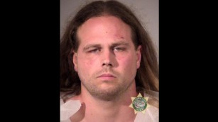 Portland stabbing suspect yells in court: Free speech or die