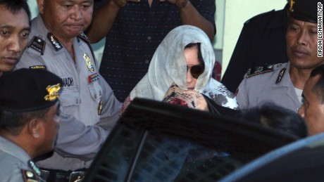 Australian drug smuggler Schapelle Corby covered her head with a scarf is escorted by Indonesian police officers to get on a car as she leaves the parole office in Bali, Indonesia, Saturday, May 27. Indonesia on Saturday deported Corby, whose trial and imprisonment on the tourist island of Bali mesmerized her homeland for more than a decade. She was arrested in 2004 after customs officers at Bali's international airport found 9 pounds of marijuana inside her boogie board bag, sparking a media frenzy in Australia on par with America's O.J. Simpson trial.