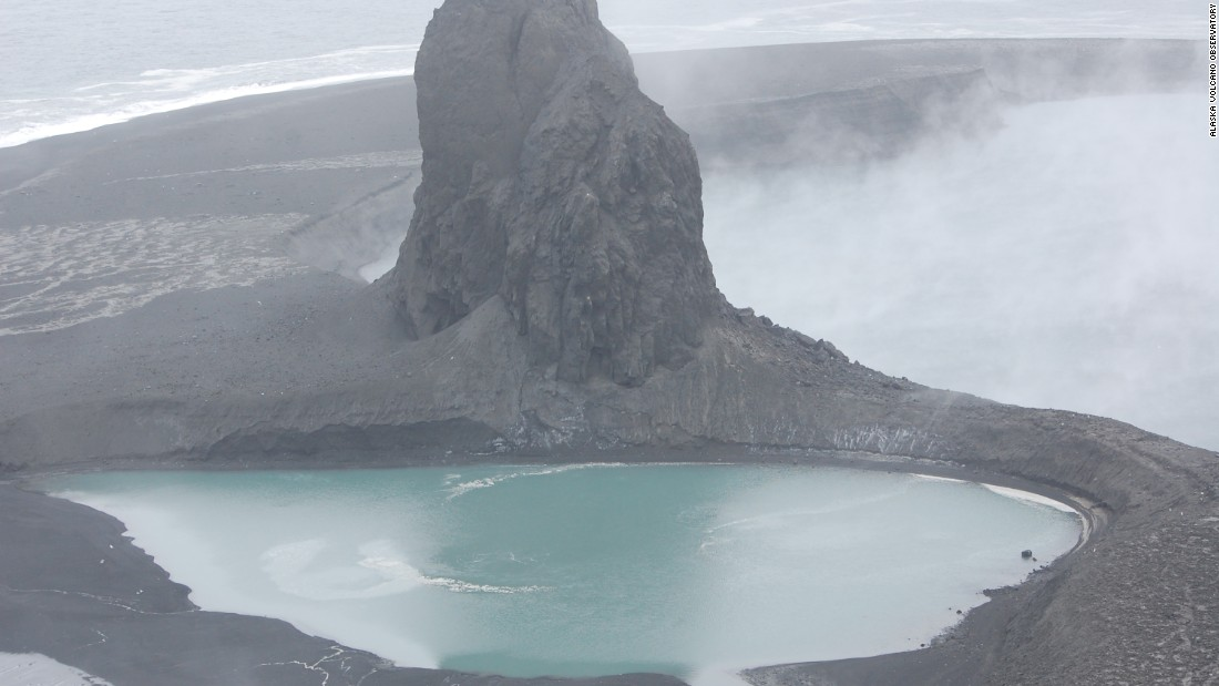 This May 8 file photo of the Bogoslof volcano in Alaska's Aleutian islands shows a crater now filled by a warm saltwater lake. The volcano erupted on Bogoslof Island on Sunday, May 28, producing an ash cloud that reached up to 45,000 feet, according to the Alaska Volcano Observatory.
