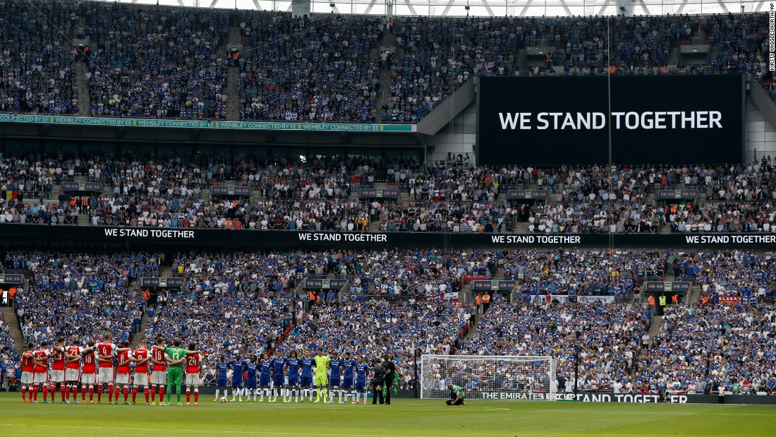 "Soccer players from Arsenal and Chelsea pause for a minute's silence before the FA Cup final in London on Saturday, May 27. They were paying tribute to victims of <a href=""http://www.cnn.com/2017/05/22/europe/gallery/manchester-arena-incident/index.html"" target=""_blank"">the recent bomb attack</a> in Manchester, England."