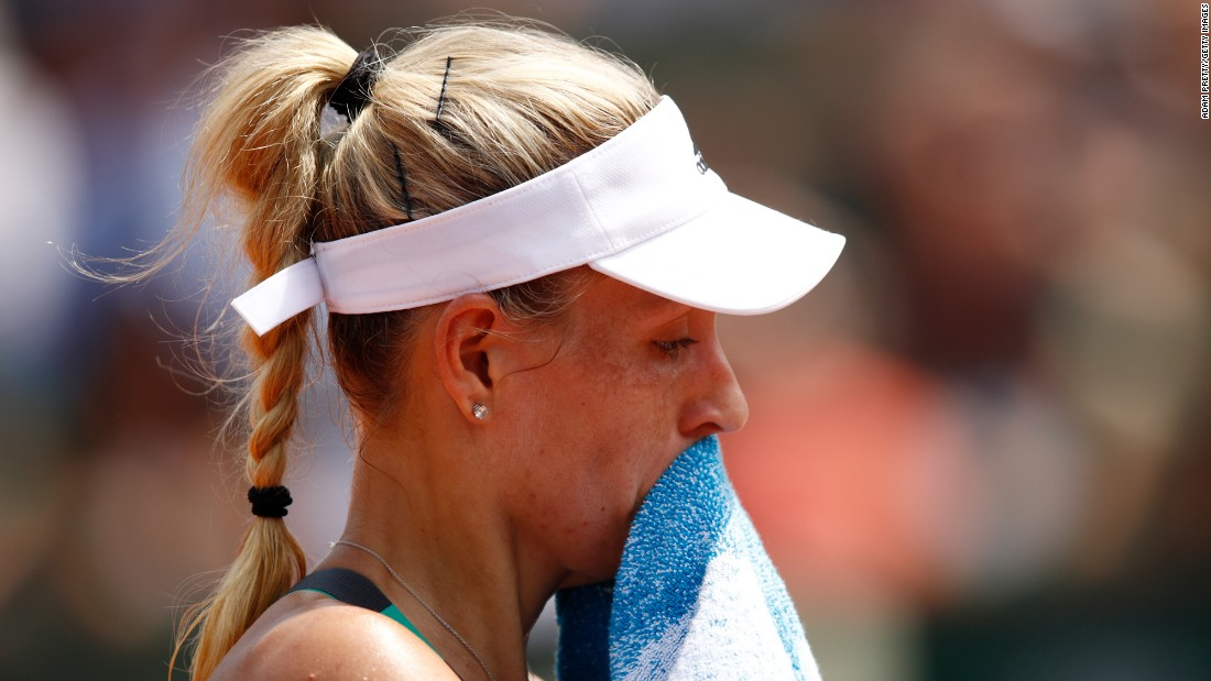"Angelique Kerber, the world's No. 1 tennis player, reacts during her French Open match against Ekaterina Makarova on Sunday, May 28. <a href=""http://www.cnn.com/2017/05/28/tennis/angelique-kerber-french-open-ekaterina-makarova/"" target=""_blank"">Kerber lost 6-2, 6-2,</a> becoming the first top-seeded woman ever to lose in the tournament's first round."