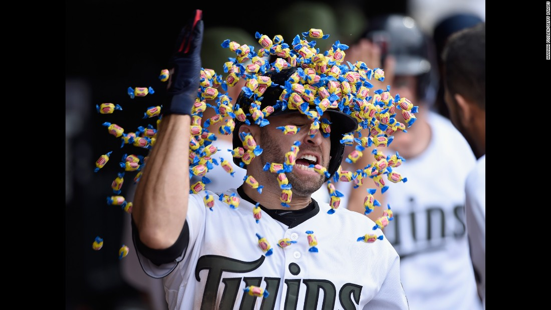 Minnesota's Brian Dozier gets a bubble-gum shower from a teammate after hitting a home run against Tampa Bay on Saturday, May 27. The two-run blast in the eighth inning lifted the Twins to a 5-3 victory.