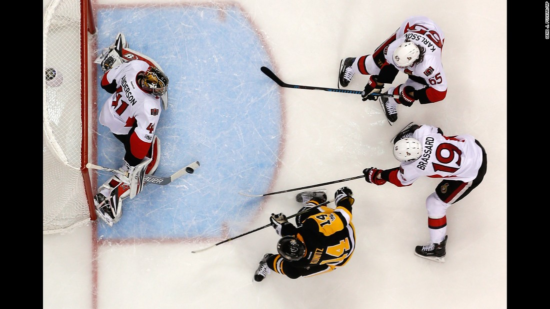 Pittsburgh's Chris Kunitz, bottom, scores a goal against Ottawa during Game 7 of the NHL's Eastern Conference Final on Thursday, May 25. Kunitz also scored the game-winning goal in double overtime.