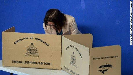 A woman casts her vote during primary elections in Honduras, ahead of the November 26 general elections, on March 12, 2017 in Tegucigalpa.  President Juan Orlando Hernandez, of the National Party and who seeks reelection, Xiomara Castro -the wife of ousted president Manuel Zelaya- at the head of the Libertad y Refundacion (LIBRE) party, and Economist Gabriela Nunez and university scholar Luis Zelaya for the opposition Liberal party take part in the electoral contest. / AFP PHOTO / ORLANDO SIERRA        (Photo credit should read ORLANDO SIERRA/AFP/Getty Images)