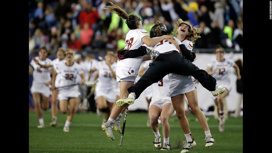 Boston College lacrosse players celebrate after winning their NCAA semifinal against Navy on Friday, May 26.