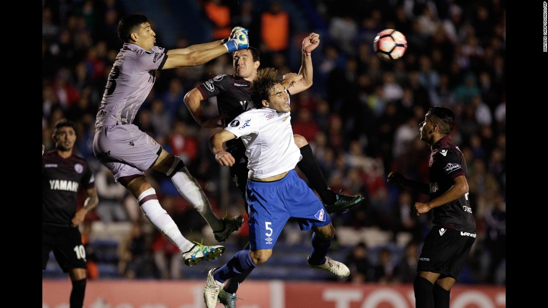 Lanus goalkeeper Esteban Andrada punches the ball away during a Copa Libertadores match in Montevideo, Uruguay, on Tuesday, May 23.