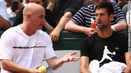PARIS, FRANCE - MAY 28:  Novak Djokovic of Serbia in discussion with coach Andre Agassi during practice on day one of the 2017 French Open at Roland Garros on May 28, 2017 in Paris, France.  (Photo by Julian Finney/Getty Images)