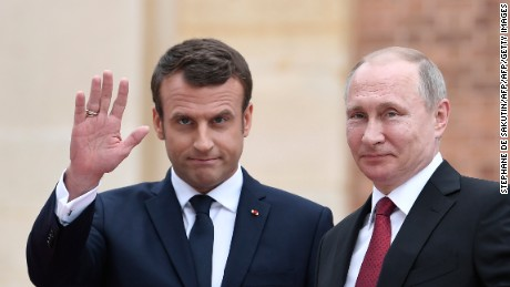 Russian President Vladimir Putin (R) is welcomed by French President Emmanuel Macron (L) at the Versailles Palace, near Paris, on May 29, 2017, ahead of their meeting. French President Emmanuel Macron hosts Russian counterpart Vladimir Putin in their first meeting since he came to office with differences on Ukraine and Syria clearly visible. / AFP PHOTO / STEPHANE DE SAKUTIN        (Photo credit should read STEPHANE DE SAKUTIN/AFP/Getty Images)