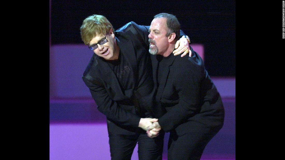 John and Billy Joel dance during the final song of a Brian Wilson tribute in New York in 2001. Wilson was one of the original Beach Boys.