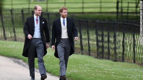 TOPSHOT - Britain's Prince Harry (R) and Britain's Prince William, Duke of Cambridge walk to the church for the wedding of Pippa Middleton and James Matthews at St Mark's Church in Englefield, west of London, on May 20, 2017. Pippa Middleton hit the headlines with a figure-hugging outfit at her sister Kate's wedding to Prince William but now the world-famous bridesmaid is becoming a bride herself. Once again, all eyes will be on her dress as the 33-year-old marries financier James Matthews on Saturday at a lavish society wedding where William and Kate's children will play starring roles. / AFP PHOTO / POOL / Justin TALLIS        (Photo credit should read JUSTIN TALLIS/AFP/Getty Images)