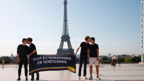 "Gay rights activists denounce persecution against the LGBT community in Chechnya in Paris on Monday. Their sign reads ""Stop homophobia in Chechnya."""
