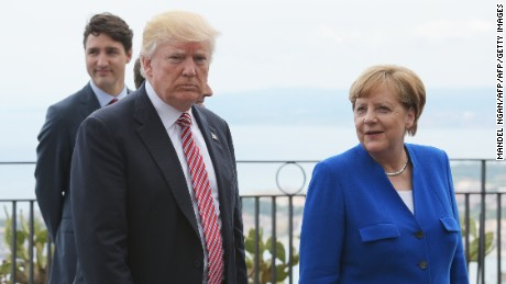US President Donald Trump (L) walks alonf with German Chancellor Angela Merkel at the Belvedere of Taormina during the Summit of the Heads of State and of Government of the G7, the group of most industrialized economies, plus the European Union, on May 26, 2017 in Sicily. The leaders of Britain, Canada, France, Germany, Japan, the US and Italy will be joined by representatives of the European Union and the International Monetary Fund (IMF) as well as teams from Ethiopia, Kenya, Niger, Nigeria and Tunisia during the summit from May 26 to 27, 2017. / AFP PHOTO / MANDEL NGAN        (Photo credit should read MANDEL NGAN/AFP/Getty Images)