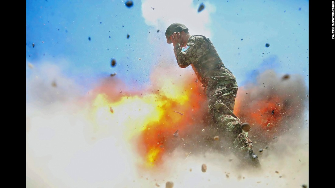 "In this photo -- <a href=""http://www.cnn.com/2017/05/03/us/moment-of-explosion-trnd/"" target=""_blank"">published this month</a> by Military Review, the US Army's professional journal -- a mortar tube explodes near an Afghan soldier during a training exercise in July 2013. The photo was taken by US Army Spc. Hilda Clayton, a combat photographer who was killed in the accident along with three Afghan soldiers and the Afghan photographer she was training. Clayton's family approved the release of the photo, <a href=""https://www.stripes.com/news/army-releases-images-of-combat-photographer-s-final-moments-before-fatal-blast-1.466230#.WQua-LvyvJy"" target=""_blank"">according to the Stars and Stripes newspaper,</a> and the Military Review featured it as part of its issue on gender equality."