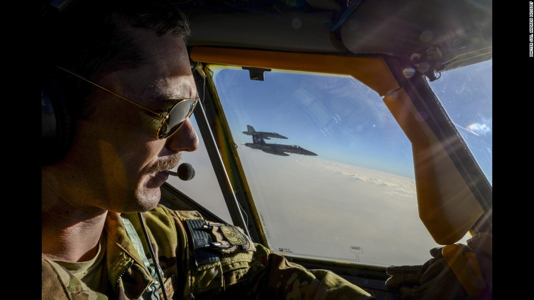 Air Force Capt. Timothy Black pilots a KC-135 Stratotanker next to two Navy fighter jets on Sunday, May 21. The Stratotanker is part of a refueling squadron that is supporting the mission against ISIS.