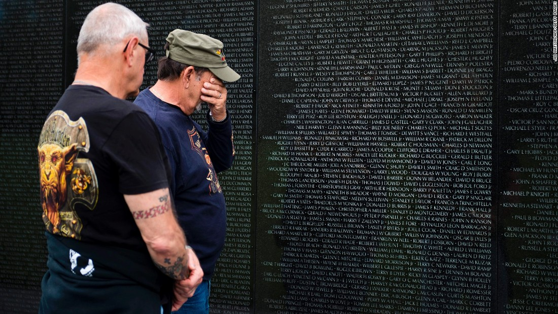 Vietnam veterans Ed Hriscko, left, and Skip Georgal visit the Vietnam War Memorial in Washington on Friday, May 26.