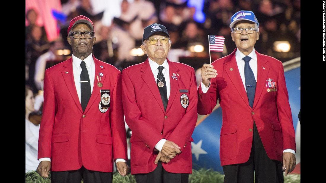 "<a href=""http://www.cnn.com/2015/01/12/us/feat-tuskegee-airmen-obit/"" target=""_blank"">Tuskegee Airmen</a> walk on stage during the National Memorial Day concert in Washington on Sunday, May 28."