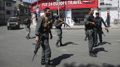 Security forces stand near the site of the bombing on Wednesday.