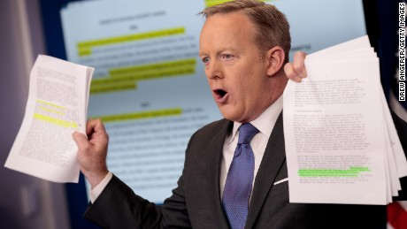 WASHINGTON, DC - JANUARY 30: White House Press Secretary Sean Spicer holds up paperwork highlighting and comparing language about the National Security Council from the Trump administration and previous administrations during the daily press briefing at the White House, January 30, 2017 in Washington, DC. U.S. President Donald Trump announced Monday that he will reveal his 'unbelievably highly respected' pick to replace the late Supreme Court Antonin Scalia on Tuesday evening. (Photo by Drew Angerer/Getty Images)