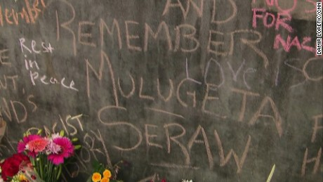 A message in front of Portland's Hollywood metro station honors murder victim Mulugeta Seraw.