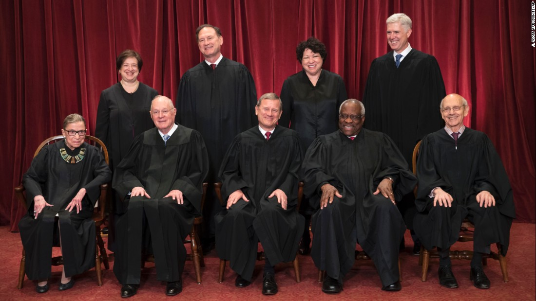 The justices of the US Supreme Court sit for an official photograph on June 1, 2017. In the front row, from left, are Ruth Bader Ginsburg, Anthony Kennedy, Chief Justice John Roberts, Clarence Thomas and Stephen Breyer. In the back row, from left, are Elena Kagan, Samuel Alito, Sonia Sotomayor and Neil Gorsuch.