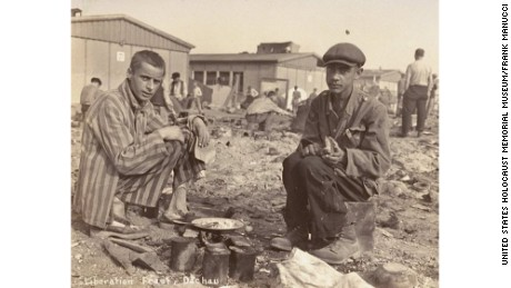 Caption: Two survivors prepare food outside the barracks. The man on the right, presumably, is Jean (Johnny) Voste, born in Belgian Congo, who was the only black prisoner in Dachau.  Photo Credit: United States Holocaust Memorial Museum, courtesy of Frank Manucci  Date: May 1945