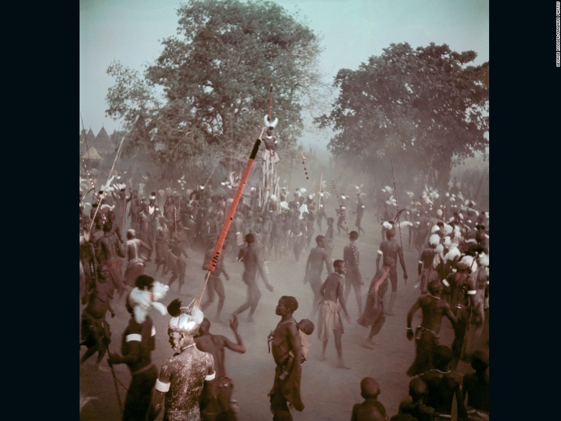Latuka people perform a rain dance, 1948. The annual event takes place to bring luck to the harvest and ends with an animal sacrifice. The size of the animal, caught by Moyimiji warriors, correlates to the size of the harvest -- so the larger the beast the better. <br /><br />